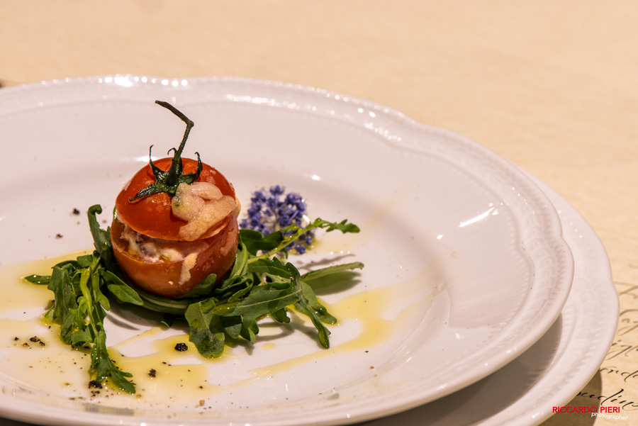 a tiny sweet tomato filled with creamy ricotta cheese / a veryyummy starter