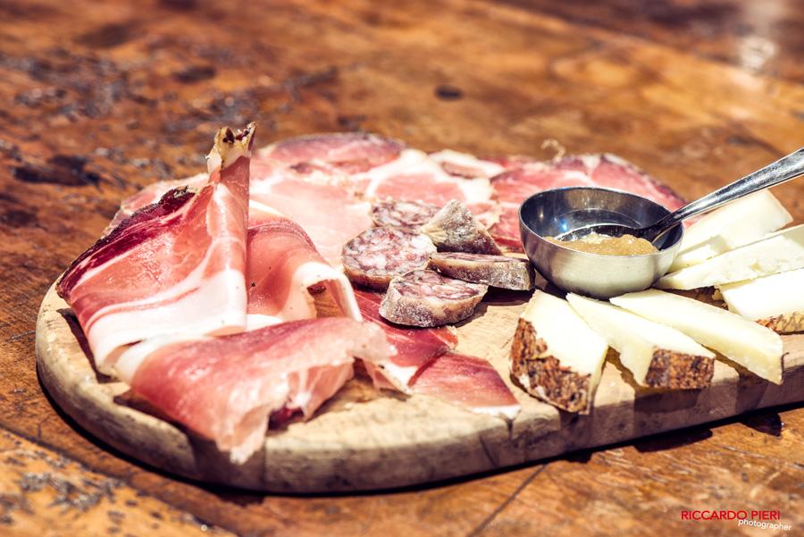 a salumi platter with truffle salami and great pecorino cheese